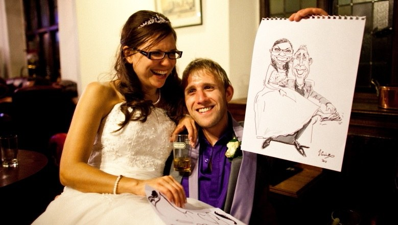 Previous customers with caricature of their wedding day